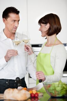 Free Happy Couple Toasting With Glass Of Wine Stock Photography - 17799432