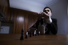 Free Thoughtful Man Throwing Chess In The Cup. Royalty Free Stock Photo - 17799865