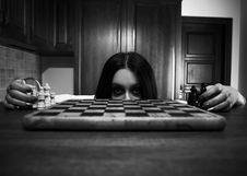 Free Frightened Girl Looking Out Of Chess Board Royalty Free Stock Image - 17799876
