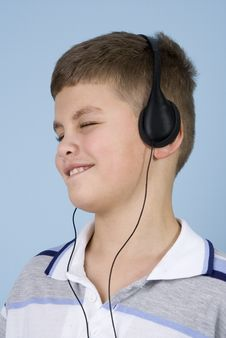 Young Boy Listening To Music On Headphones Royalty Free Stock Image