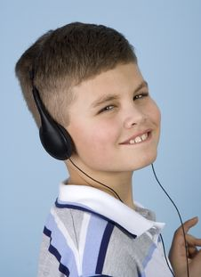 Young Boy Listening To Music On Headphones Stock Image