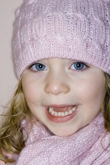 Blue Eyed Girl With Hat And Scarf Laughing Royalty Free Stock Photo