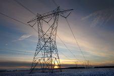 Free High Volatge Pylon At Sunset In Winter Royalty Free Stock Photo - 17801635