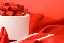 Free Box With A Gift On A Red Fabric Stock Image - 17805611
