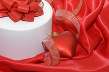 Free Box With A Gift On A Red Fabric Stock Photography - 17805662