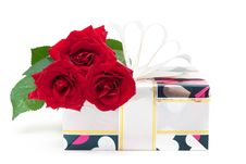 Free Gift Decorated With Ribbon And Red Roses Royalty Free Stock Photography - 17809617