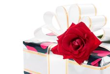 Free Gift Decorated With Ribbon And Red Roses Stock Photos - 17809633