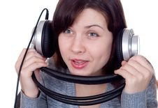 The Girl In Ear-phones Stock Photo