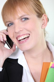 Young Businesswoman Smiling On Phone Stock Photography