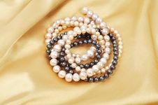 Silk And Pearls Stock Images