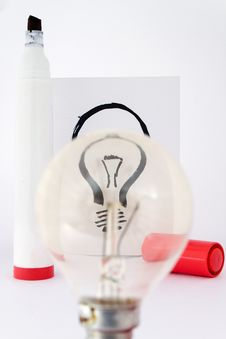Lightbulb And Drawing Pen Stock Images