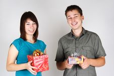 Free Girl And Man Holding Gifts And Smiling Royalty Free Stock Images - 17813779