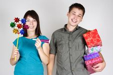 Free Man And Girl Holding Many Gifts And Smiling Stock Images - 17813804