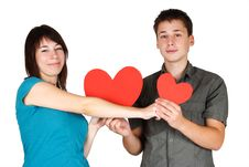 Girl And Man Holding Two Paper Hearts, Smiling Royalty Free Stock Photography