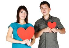Girl And Man Holding Two Paper Hearts, Smiling Stock Image