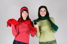 Two Young Girls In Warm Scarfs And Hats