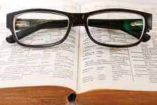 Free Closeup Of Old Dictionary And Glasses Royalty Free Stock Image - 17814036