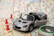 Toy Car On A Geographical Atlas Royalty Free Stock Image