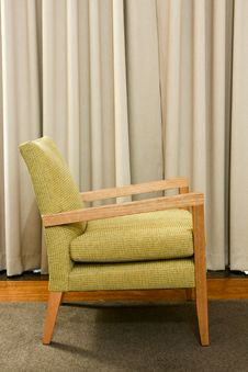 Free Green Wooden And Upholstered Chair On Rug. Royalty Free Stock Photography - 17815247