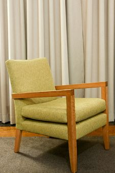 Free Green Wooden And Upholstered Chair On Rug. Stock Images - 17815304