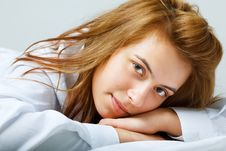 Smiling Young Woman Lying On The Floor Royalty Free Stock Photos