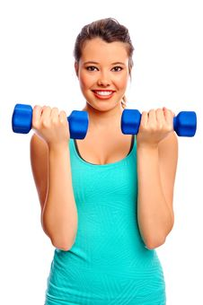 Pretty Woman With Dumbbells Royalty Free Stock Image