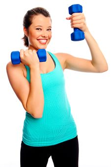 Pretty Woman With Dumbbells Royalty Free Stock Photography