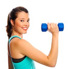 Pretty Woman With Dumbbells Stock Images