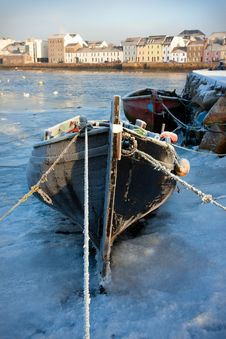 Boats In Ice On The Bank Of River