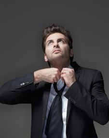 Free Businessman Loosening Tie Royalty Free Stock Images - 17819559