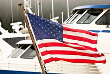 Free American Flag Flying ALongside Baots In A Harbor Royalty Free Stock Image - 17819596