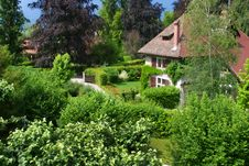 Old House In France With A Beautiful Green Garden