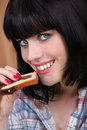 Free Portrait Of A Young Woman Eating Cake Royalty Free Stock Photography - 17823587
