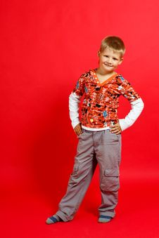 Free Little Boy On A Red Background Stock Photos - 17820723