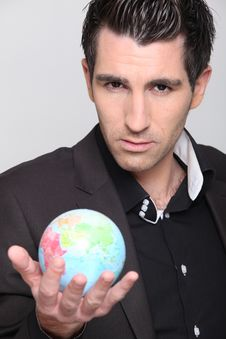 Free Portrait Of A Man In Suit Holding A Globe Royalty Free Stock Photo - 17821565