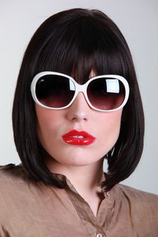 Portrait Of A Young Brunette With Sunglasses Royalty Free Stock Photography