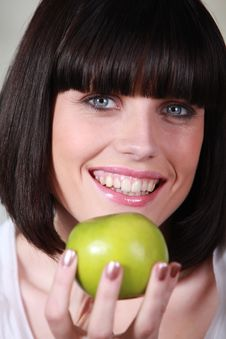 Free Portrait Of A Young Woman With Apple Stock Image - 17823501