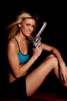 Free Woman Blue Halter Gun Black Smile Stock Image - 17826271