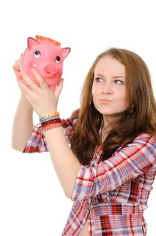 Young Woman  With Piggy Bank Stock Images