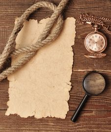 Old Paper With Pocket Watch And Magnifying Glass Stock Images