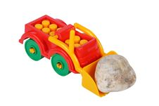Free Tractor Toy And Stone Royalty Free Stock Photography - 17828757