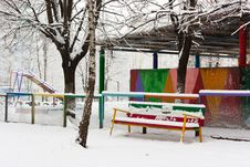 Colorful Bench In Snow In Park Royalty Free Stock Image