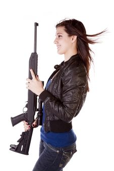 Profile Of Woman With Black Gun Smile Royalty Free Stock Photography