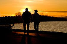Free Couple Walking Along Waterfront At Sunset Royalty Free Stock Photo - 17833915