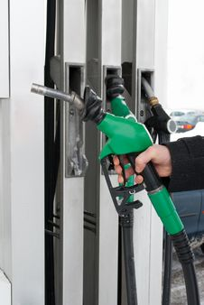 Free Fuel Nozzle In Hand Stock Photography - 17834712