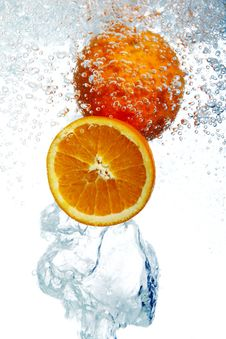 Oranges Dropped Into Water Stock Photography