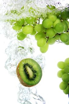 Free Kiwi And Grape Dropped Into Water Stock Photo - 17835070