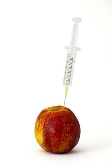 Free Syringe Stuck Into An Apple Stock Photo - 17836960