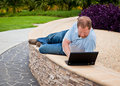 Free Man In Park Using Laptop Computer Royalty Free Stock Photo - 17846875