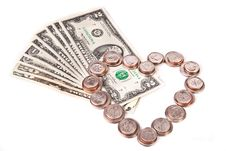 Heart Made Of Coins And Dollars Royalty Free Stock Photos